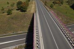 Road bridge over highway stock images