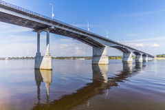 Road bridge over a large river. Stream crossing, view of the receding bridge, water surface, highway bridge, road bridge, prospect of a bridge across a large Royalty Free Stock Photography