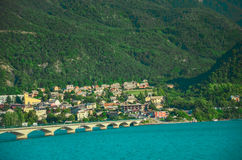 Road bridge over the reservoir Lac de Serre-Ponson in the southeast of France at the Durance River. Provence, the Alps.Savines-le- Royalty Free Stock Images
