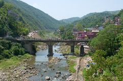 Road bridge over the river in the city of Mandi. Himachal Pradesh, India Stock Photo