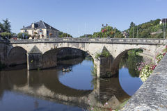 Road Bridge over River Vézère at Montignac. On the north bank looking west along the river Vézère towards the road bridge built in 1776 in the centre royalty free stock image