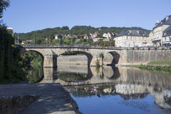 Road Bridge over River Vézère at Montignac. On the south bank looking west along the river Vézère towards the road bridge built in 1776 in the centre royalty free stock photo