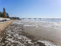 Road bridge over the Volga river between Saratov and Engels, Russia. Ice drift on the river in spring Stock Photos