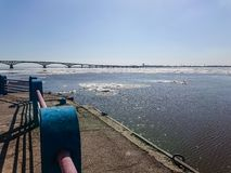 Road bridge over the Volga river between Saratov and Engels, Russia. Ice drift on the river in spring Stock Photography
