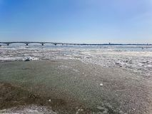 Road bridge over the Volga river between Saratov and Engels, Russia. Ice drift on the river in spring Stock Images