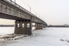 Road bridge over winter river Irtysh. Omsk, Siberia, Russia. Royalty Free Stock Photography