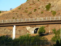 Road bridge and Railway Tunnel Royalty Free Stock Photos