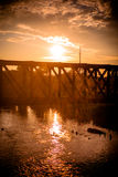 Road bridge on river during a golden sunset in royalty free stock photos