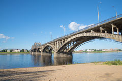 The road bridge in Rybinsk, day in july. View from the left bank of the Volga river Stock Photos