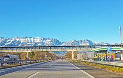 Road and bridge in snow covered Swiss mountains in winter Stock Photo
