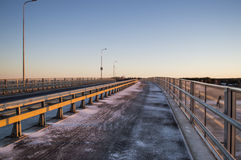 Road on a bridge. With sunrise glow Royalty Free Stock Photo