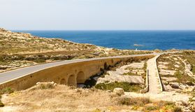 Road and Bridge to Azure Window Stock Images