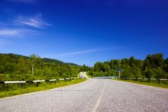 Road with bridge in the woody hills Royalty Free Stock Photography