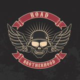 Road brotherhood. Skull in motorcycle helmet and goggles. Stock Images