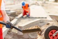 Road builder holding shovel Stock Photography