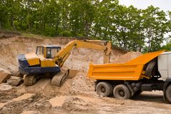Road-building. Excavator and truck Stock Photo