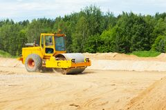 Road building roller. Roller preparing ground for building a new road Stock Photos