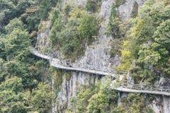 A road built along the face of a cliff stock photos
