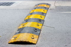 Road bump. In yellow and black Royalty Free Stock Image