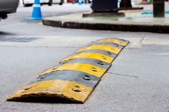 Road bump. In yellow and black Royalty Free Stock Photos