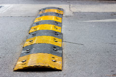 Road bump. In yellow and black color Royalty Free Stock Image