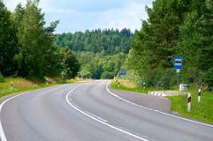 Road with Bus Stop. View to Country Road with Bus Stop Royalty Free Stock Photo