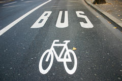 Road for buses and cycles. Road traffic sign of cycle and buses on the asphalt in the cities Stock Photo