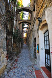 Road in Bussana Vecchia. The village known as Bussana Vecchia was destroyed by an earthquake in 1887 and subsequently abandoned. The survivors moved a few stock photography