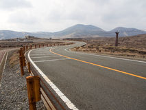 Road with cable car pylon on mountains stock photos