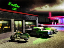 Road cafe. Exterior night scene. Close to a road, a cafe and gas station illuminated by neons. Several cars and motorcycles outside Royalty Free Stock Photography