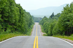 Road in Cape of Breton Highlands national park. Road through Cape of Breton Highlands national park in Nova Scotia, Canada stock image