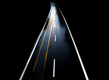 ROAD WITH CAR ALONE AT NIGHT WITH BLURRY LIGHTS Stock Images