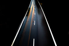 ROAD WITH CAR ALONE AT NIGHT WITH BLURRY LIGHTS Stock Photos