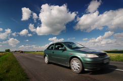 Road, car, blue cloudy sky Royalty Free Stock Images