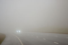 Road and a car in fog Royalty Free Stock Image