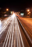 Road with car light. Road with car traffic at night and blurry lights showing speed and motion Royalty Free Stock Image