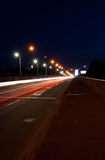 Road with car light. Road with car traffic at night and blurry lights showing speed and motion Royalty Free Stock Photo