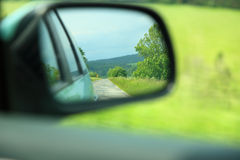 Road car rear view mirror motion blur background Stock Image