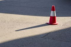 Road safety cones on asphalt. Road car safety cones on asphalt with sunny day stock photos