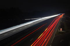 Road with car traffic at night with blurry lights Royalty Free Stock Photo