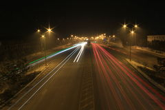 Road with car traffic at night with blurry lights Royalty Free Stock Photos