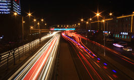 Road with car traffic at night with blurry lights Royalty Free Stock Photography
