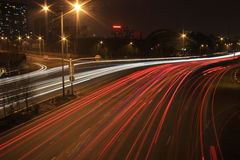 Road with car traffic at night with blurry lights Royalty Free Stock Images