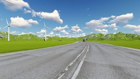 Road with car truck lorries moving both directions and wind turbine. Mills stock footage