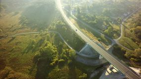 Road for cars aerial view from top around green nature.  stock images
