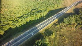 Road for cars aerial view from top around green nature.  royalty free stock image