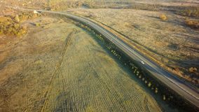 Road for cars aerial view from top around green nature.  royalty free stock images