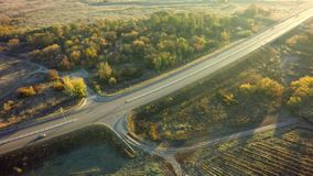 Road for cars aerial view from top around green nature.  stock photos