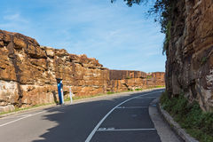 A road for cars along the Bondi to Coogee coastal walk, Sydney, Australia. A cliff top coastal walk featuring stunning views, beaches, parks, cliffs, bays and Royalty Free Stock Images