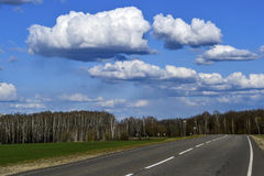Road without cars with clouds Stock Photography